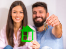 Couple moving home. Young happy couple holding keys to new home, moving to a new home Royalty Free Stock Photo