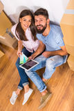Couple moving home. Young happy couple preparing for a repair in the new home, moving to a new home Royalty Free Stock Photo