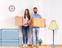 Couple moving home. Young happy couple moving to a new home, opening boxes Stock Photography