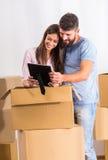 Couple moving home Stock Photos