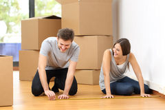 Couple moving house and measuring Stock Photos