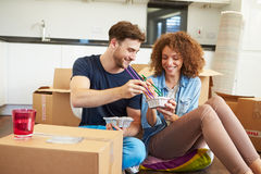 Couple Moving Into New Home Enjoying Takeaway Meal Royalty Free Stock Photo