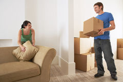 Couple Moving Into New Home Stock Images