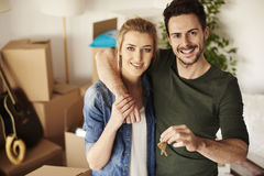 Couple moving new home. Loving couple with keys to new home Royalty Free Stock Photography