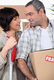 Couple moving into new home Royalty Free Stock Photos