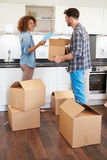 Couple Moving Into New Home And Unpacking Boxes Royalty Free Stock Photography
