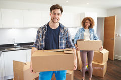 Couple Moving Into New Home And Unpacking Boxes Royalty Free Stock Photos