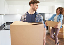 Couple Moving Into New Home And Unpacking Boxes Royalty Free Stock Image
