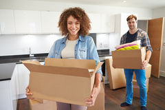 Couple Moving Into New Home And Unpacking Boxes stock photos