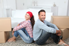 Couple moving in new house Stock Image
