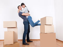 Couple moving into new house. Happy young couple moving into new house stock photos