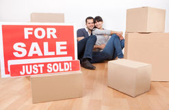 Couple moving into new house. Happy young couple moving into new house stock images