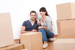Couple moving into new house. Happy young couple moving into new house stock photo