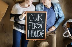 Couple moving into new house Royalty Free Stock Images