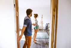 Couple moving in new house, entering through the door. Stock Image