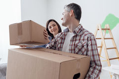 Couple moving into a new house Royalty Free Stock Photo