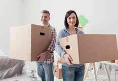 Couple moving into a new house Stock Images
