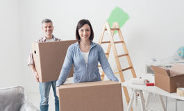 Couple moving into a new house Royalty Free Stock Photos