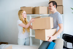 Couple moving into new house Stock Images