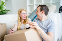 Couple moving into new house Royalty Free Stock Photos