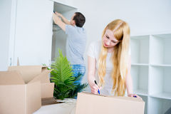 Couple moving into new house Royalty Free Stock Image