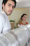 Couple moving into a new housing Royalty Free Stock Image
