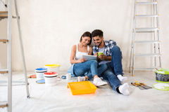 Couple moving in new renovate home. Looking new design for home Royalty Free Stock Photography