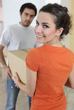 A couple moving their belongings Royalty Free Stock Photos