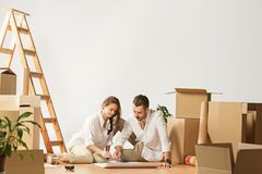 Couple moving to a new home. stock photography