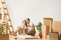 Couple moving to a new home. stock photos