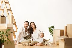 Couple moving to a new home - Happy married people buy a new apartment to start new life together stock photography
