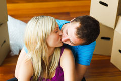 Couple moving to new house and kissing Stock Image