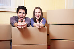 Couple with moxing boxes showing Stock Photos
