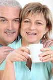 Couple with mug of coffee Royalty Free Stock Image