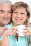 Couple with mug of coffee Royalty Free Stock Image