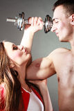 Couple muscular man and girl admiring his strength. Royalty Free Stock Image
