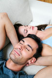 Couple Napping on the Sofa Royalty Free Stock Image