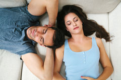 Couple Napping on the Sofa Stock Image