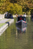 Couple on narrow boat in canal Royalty Free Stock Images