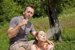 Couple in nature with e-cigarettes Royalty Free Stock Photo