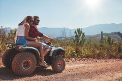 Couple in nature on a quad bike Royalty Free Stock Images
