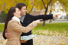 Couple navigating with city map Royalty Free Stock Images