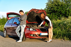 Couple near the broken car. Stock Photography