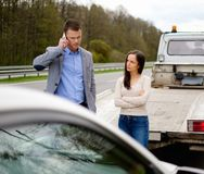 Couple near broken car Stock Photos