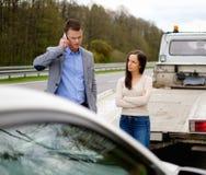 Couple near broken car Stock Photos