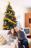 Couple near a Christmas tree Royalty Free Stock Image