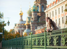 Couple near the Church of the Savior on Blood. Happy couple near the Church of the Savior on Blood in Saint-Petersburg, Russia Royalty Free Stock Photography