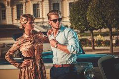 Couple near classic car