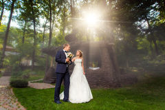 Couple near decorative house in sunlight Royalty Free Stock Images