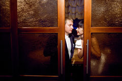 Couple near the door Stock Images